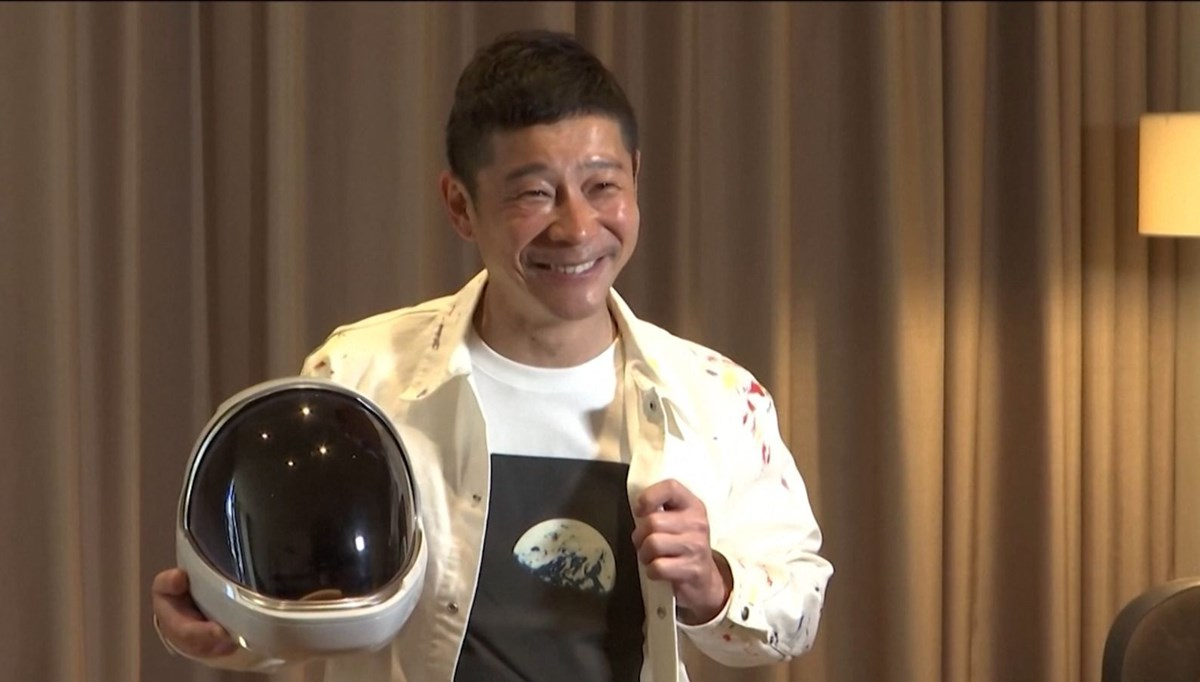 He is looking for 8 people to take with him on the moon trip