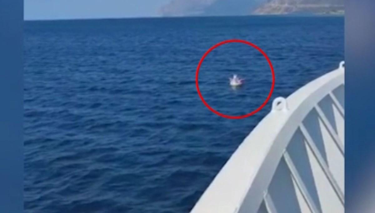 Denizde sürüklenen çocuğun kurtarılma anları