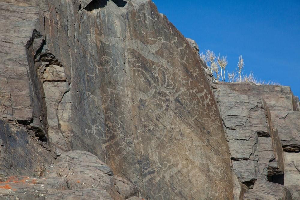 Sibirya'da 2 bin 500 yıl önce ölen savaşçı çift ile bebeğinin mezarı bulundu - 4