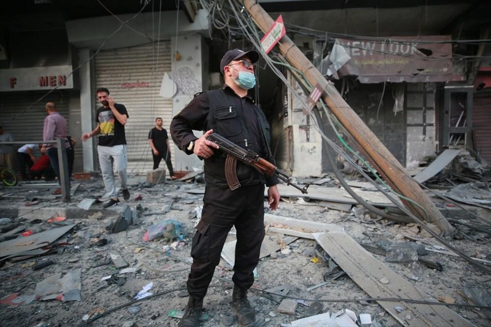 İsrail, Gazze'de sivillerin bulunduğu 14 katlı binayı vurdu - 27