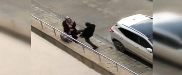 Sokak ortasında eşini tekmeleyen kişiye gözaltı