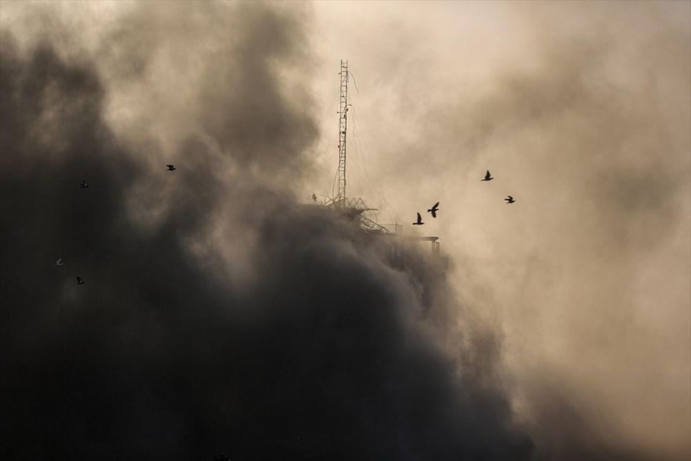 İsrail, Gazze'de sivillerin bulunduğu 14 katlı binayı vurdu - 10