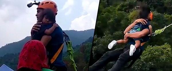 Küçük kızını kucağına alarak 'bungee jumping' yaptı
