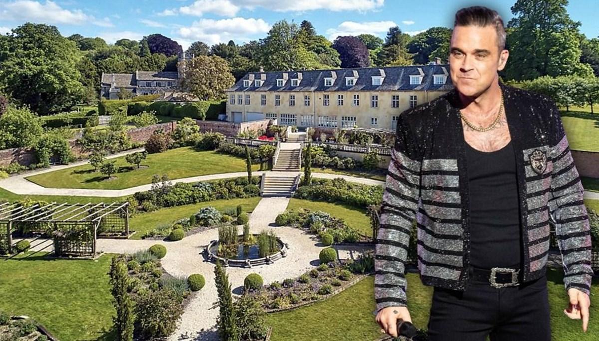 Robbie Williams oğlu korktuğu için evini zaranına satıyor