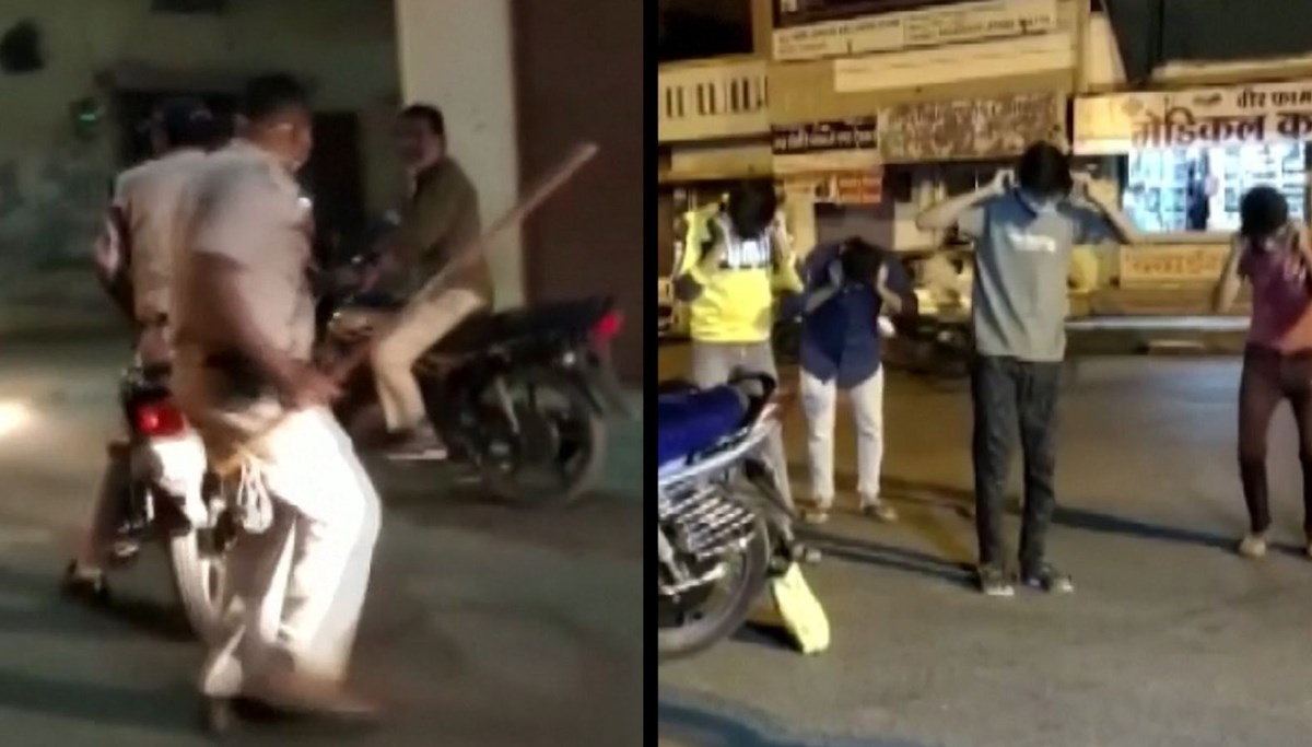 Police in India beat people on the streets with a stick