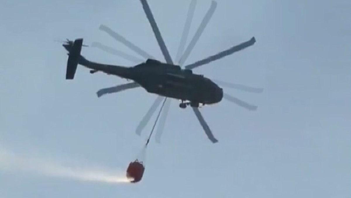 Sikorsky helikoptere su sepeti takılarak yangına müdahaleye başladı