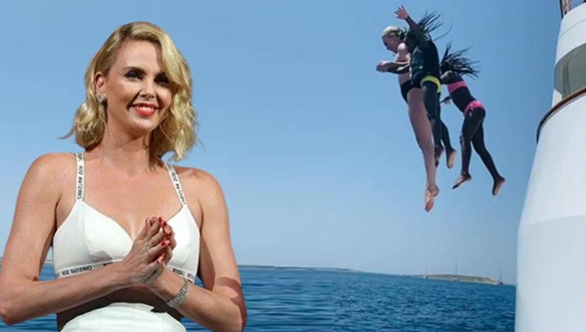 Charlize Theron çocuklarıyla tatilde: Metrelerce yüksekten atladılar