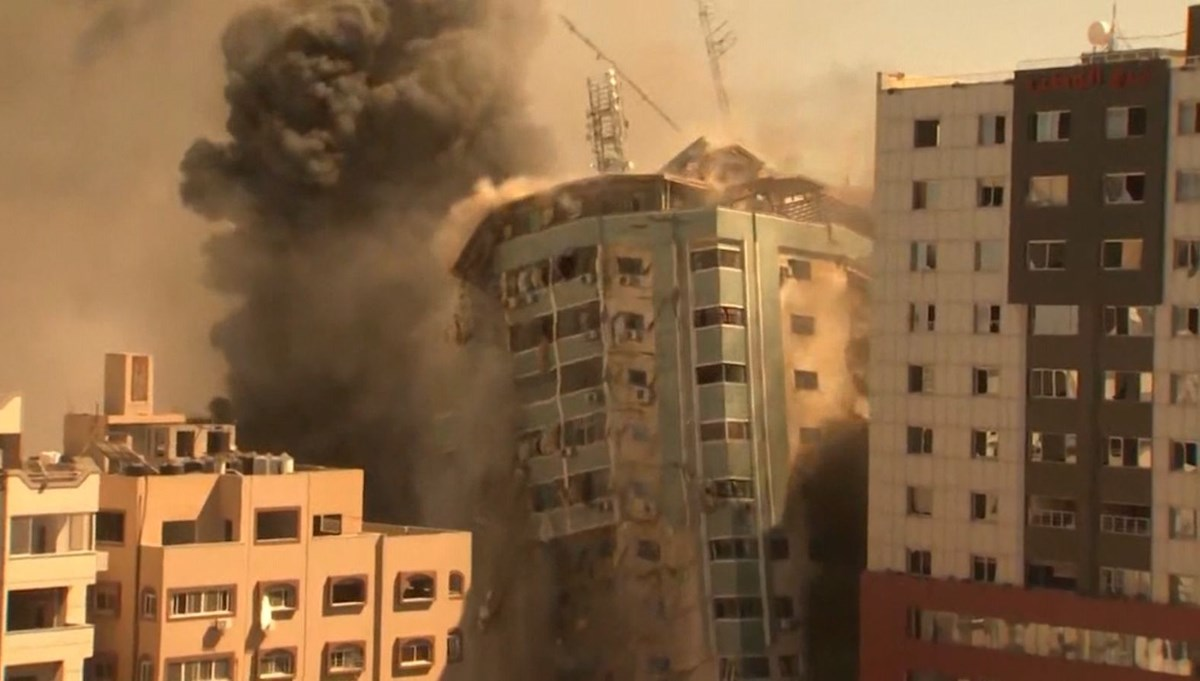 The moment the media building was shot down in Gaza
