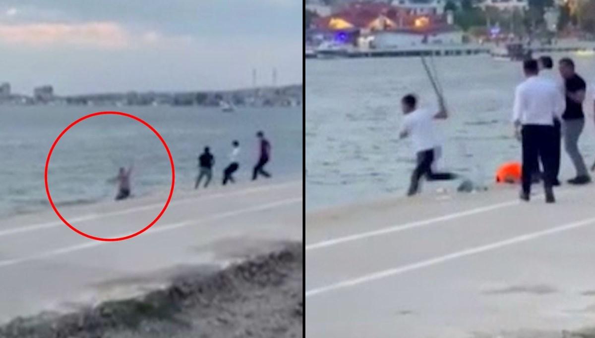 Restoran çalışanları sopayla saldırınca denize atladı