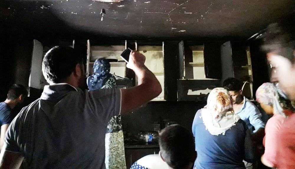 Patlayan buzdolabı yangın çıkardı: Çocuklarını kurtarmak için pencereden attı - 5