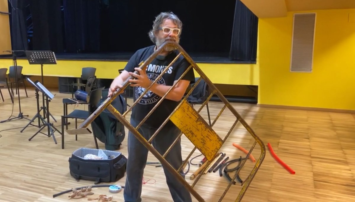 He makes music through iron barriers