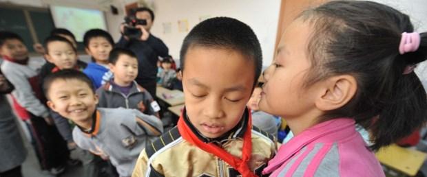 çin-tek-çocuk-politikası021115.jpg