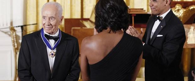 Obama'dan Peres'e: Barış savaşçısı