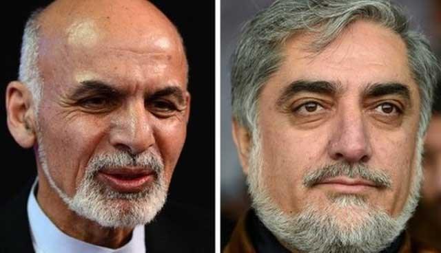 Cumhurbaşkanlı seçimlerinde eski maliye bakanı Eşref Gani Ahmadzey ile eski dışişleri bakanı Abdullah Abdullah (sağda)yarıştı.