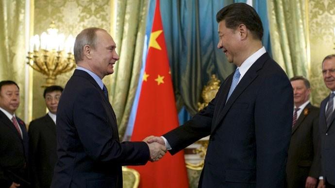 Rusya Devlet Başkanı Vladimir Putin ile Çin Devlet Başkanı Xi Jinping