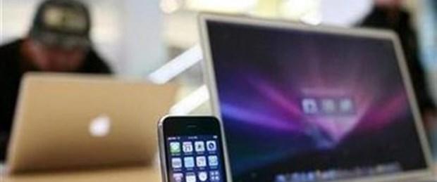 Apple kârını yarı yarıya artırdı