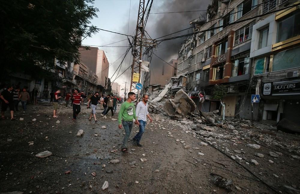İsrail, Gazze'de sivillerin bulunduğu 14 katlı binayı vurdu - 31