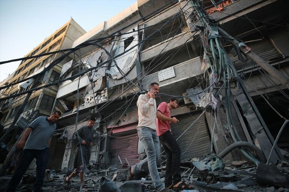 İsrail, Gazze'de sivillerin bulunduğu 14 katlı binayı vurdu - 26