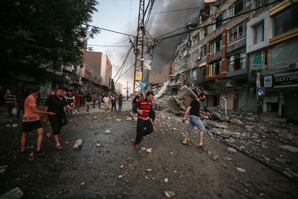 İsrail, Gazze'de sivillerin bulunduğu 14 katlı binayı vurdu - 32