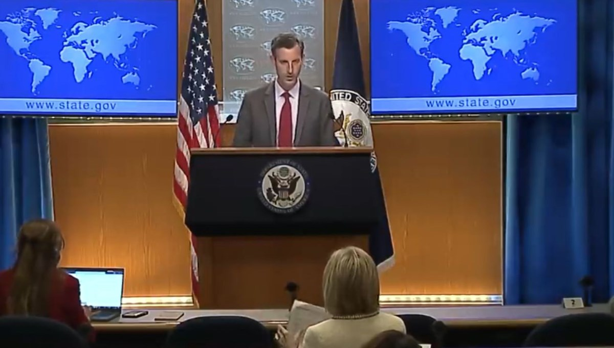 US State Department spokesman Ned Price discusses with journalists