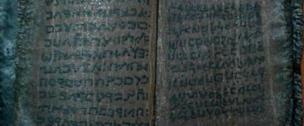 bin-800-yillik-kitabi-satmaya-calisirken-yakalandi-_9878_dhaphoto3.jpg