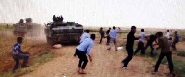 Köylüler tankları taşladı