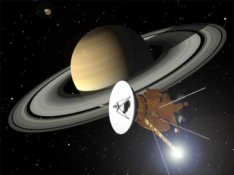 Cassini uzay aracı ve Satürn'e ait bir çizim.