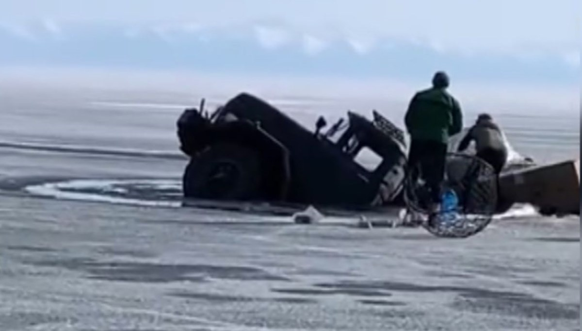 The truck suddenly went under water as the ice broke
