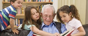 grandfather-reading-a-story-to-his-grandchild-_453408851.jpg