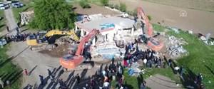 samsat-ta-deprem-yikilan-binanin-havadan-goru-10785178_amp.jpg