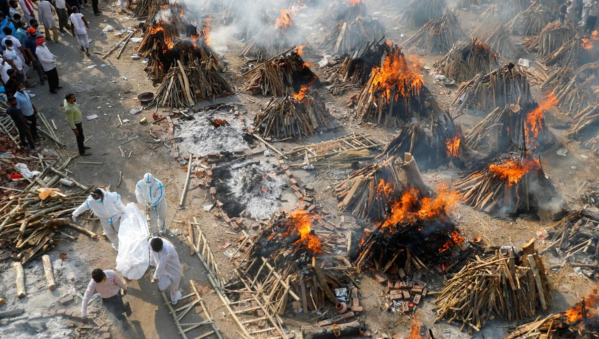 Deadliest day in India: burial fires rising from all over the country
