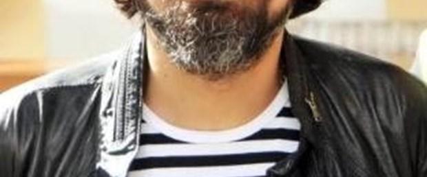 Saçı sakalı karıştı